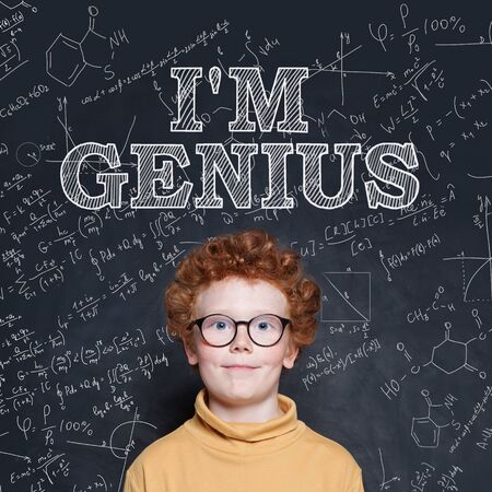 Cute kid boy in glasses on science background