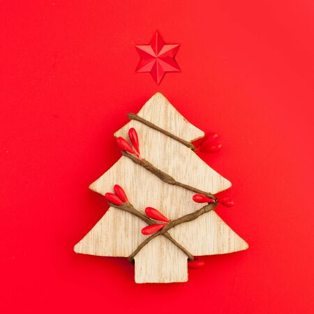 Christmas card background. Xmas tree with star concept on red background