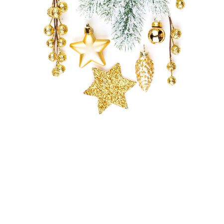 Golden Christmas border. Composition of gold stars, berries and green winter fir branch on white background with copy space
