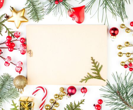 Christmas background with Xmas decorations and vintage paper card. Xmas flat lay top view Stock Photo
