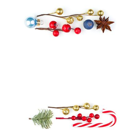 Beautiful Christmas border with red holly berries, baubles and green fir branch on white background Reklamní fotografie