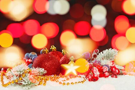 Christmas bokeh light background with green Xmas tree twig and New Year decoration Reklamní fotografie
