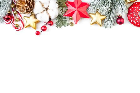 Christmas border or banner with stars, fir branch, holly berries and baubles isolated on white background