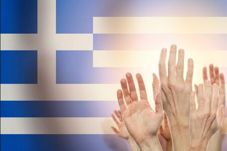 People raising hands and flag Greece on background. Patriotic concept