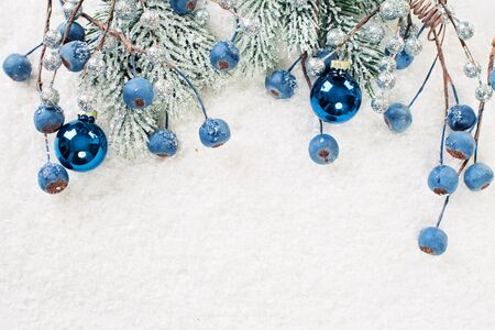 Christmas background with green Xmas tree twig and New Year decoration Stock Photo