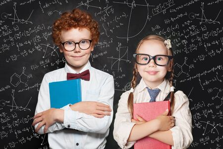 Back to school. Cute kids portrait. Little girl and boy  school student holding book
