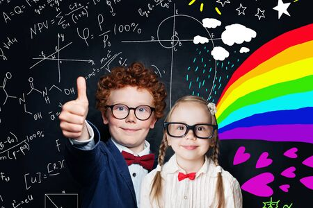 Smiling smart boy and girl on blackboard background with maths formulas and art pattern