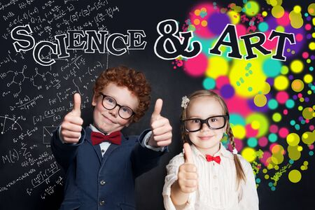 Science and art concept. Happy kids showing thumb up Zdjęcie Seryjne