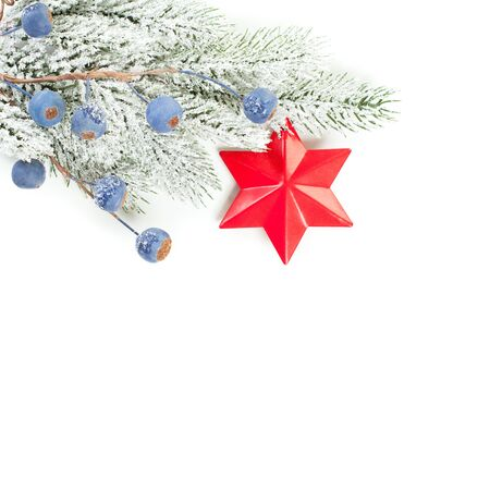 Christmas border. Green fir branches, red star and blue berries isolated on white background