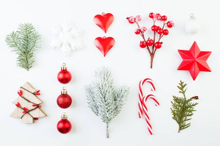 White snowflake, Xmas tree, glass baubles and green fir branch isolated on white background. Christmas composition Zdjęcie Seryjne