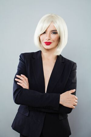 Perfect blonde woman with short hair wearing black suit