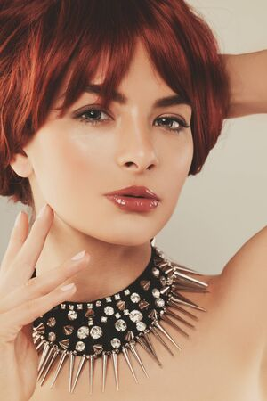 Beautiful woman with ginger hair, close up portrait Imagens