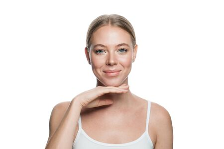 Natural beauty. Real woman face with healthy skin isolated on white