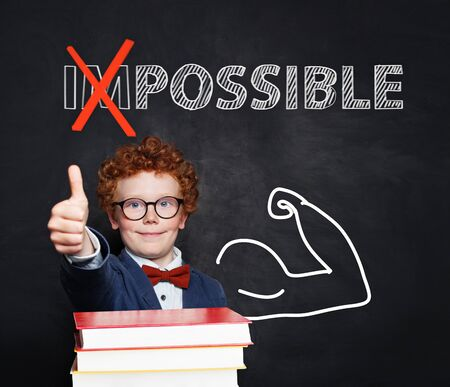 Confident smart child student showing thumb up. Possible and a lot of possibilities concept