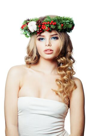 Cute young woman in Christmas crown wreath isolated on white