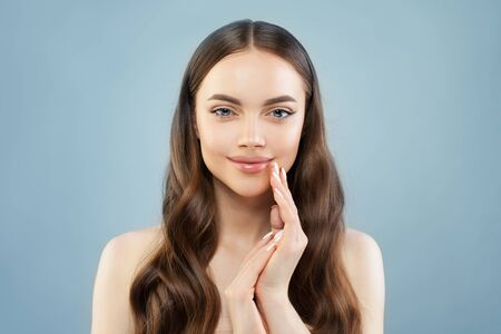 Lovely model woman with clear skin on blue background Stock Photo