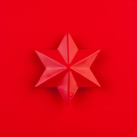 Red star on red background card