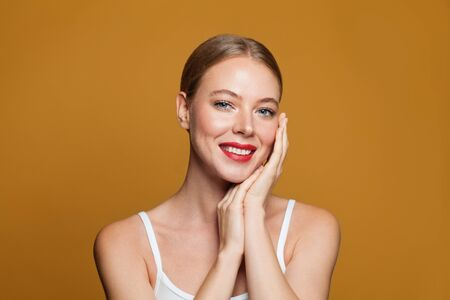 Portrait of young perfect woman with red lips