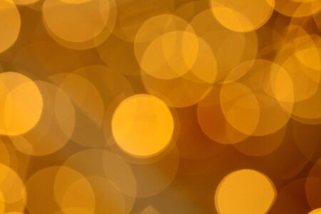 Abstract golden background with light baubles, stars and glitter