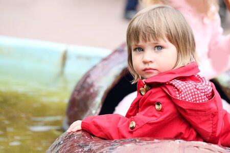 Cute Little girl in park attraction. Concept joy and Holiday