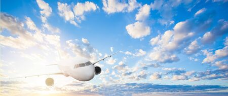 People travelling concept. Plane on skyline. Airplane, blue sky with white clouds 版權商用圖片