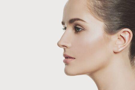 Attractive profile of young pretty woman face close up 版權商用圖片