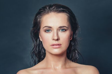 Portrait of attractive woman with wet skin and hair. Face closeup 版權商用圖片