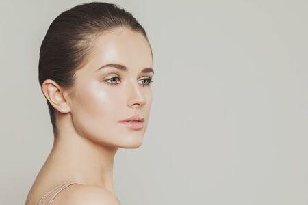 Nice woman face close up, studio portrait