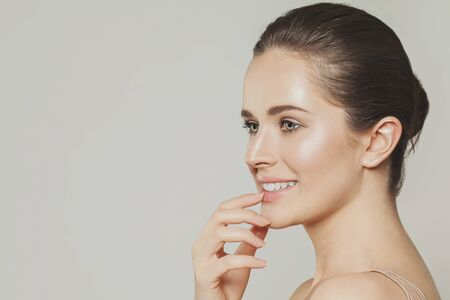 Young smiling woman face profile 版權商用圖片
