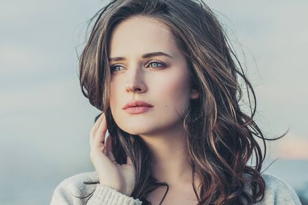 Portrait of young beautiful woman outdoor