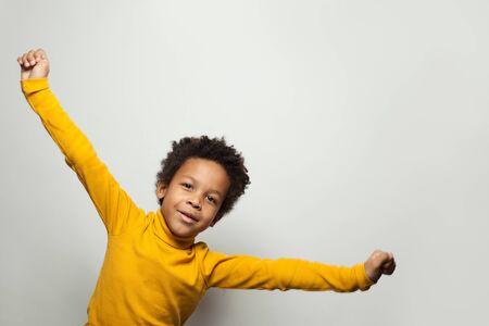Playful African American child boy on white background 版權商用圖片