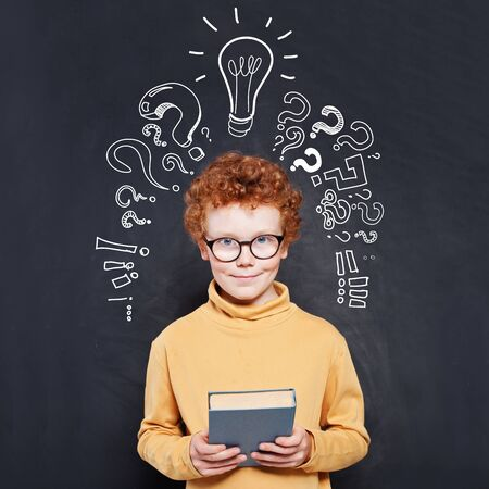 Child boy and book, idea lightbulb and question marks