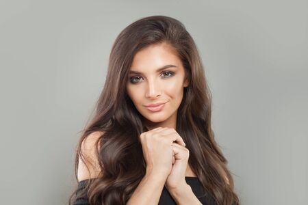 Pretty brunette model woman with long perfect hair, studio portrait 版權商用圖片