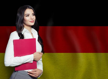 Young woman with red book. Learn or business concept 版權商用圖片