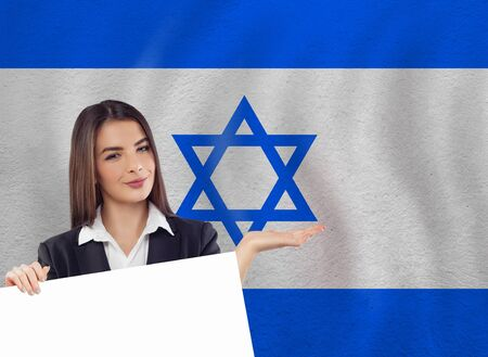 Young woman with white banner and national flag