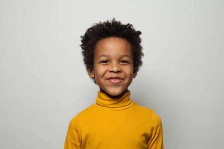 Portrait of happy little black kid boy smiling on white background 版權商用圖片