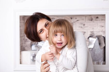 Mom and daughter hug together. Family happiness concept