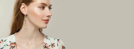Beautiful female profile on white banner background