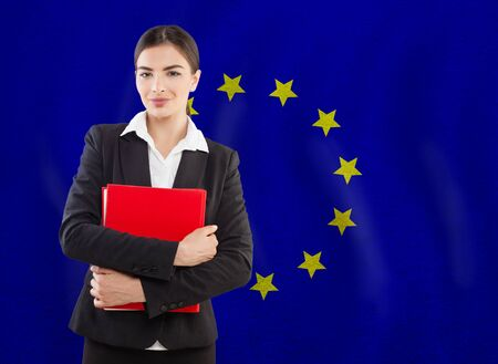 Distance learning concept. Young woman student with EU flag background Foto de archivo