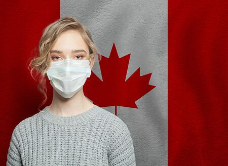 Canadian woman wearing a face mask with national flag of Canada. Flu epidemic and virus protection concept