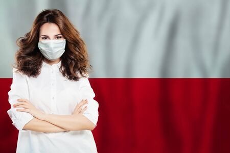 Doctor or nurse woman in medical safety face mask on Polish flag background. Flu epidemic and virus protection in Poland concept