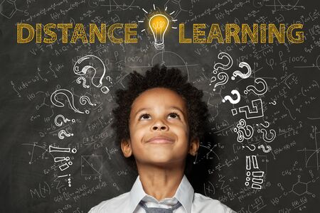 Distance learning. Black child boy with idea light bulb, question marks and science formulas