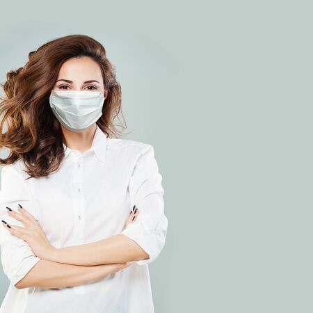 Doctor or virologist woman wearing a face mask. Woman in medical mack. Flu epidemic and virus protection concept