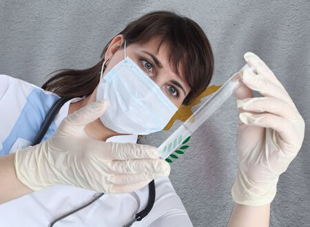 Scientist woman with test tube Coronavirus or COVID-19 against Cyprus flag. Research of viruses in laboratory for prevention of a pandemic in Cyprus Banque d'images
