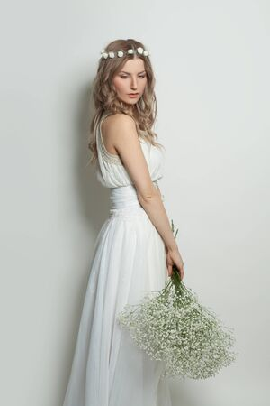 Pretty woman in white dress portrait