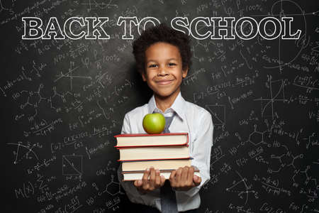 African American child student with science formulas background, back to school concept
