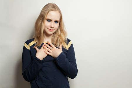 Teen girl in blue longsleeve on white background Zdjęcie Seryjne