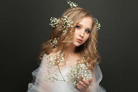 Beautiful bride woman with white flowers portrait