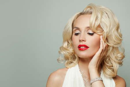 Stylish celebrity blonde woman fashion model in diamond necklace and bracelet on white