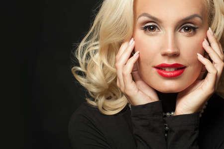 Beautiful female face close up. Glamorous woman on black background portrait